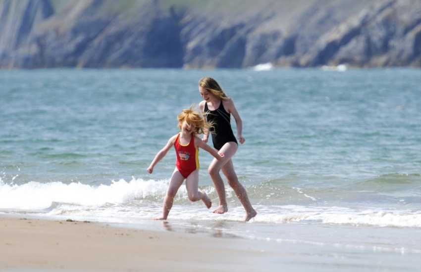 Splashing through the waves - Pembrokeshire's golden sandy beaches popular with families, surfers and great for rock pooling at low tide