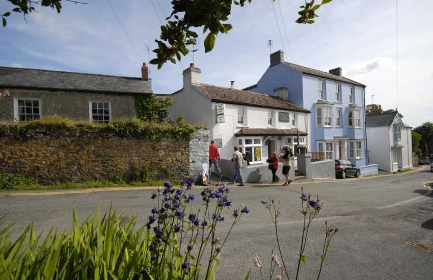 For a friendly locals pub, with good bar food, try the Castle Inn