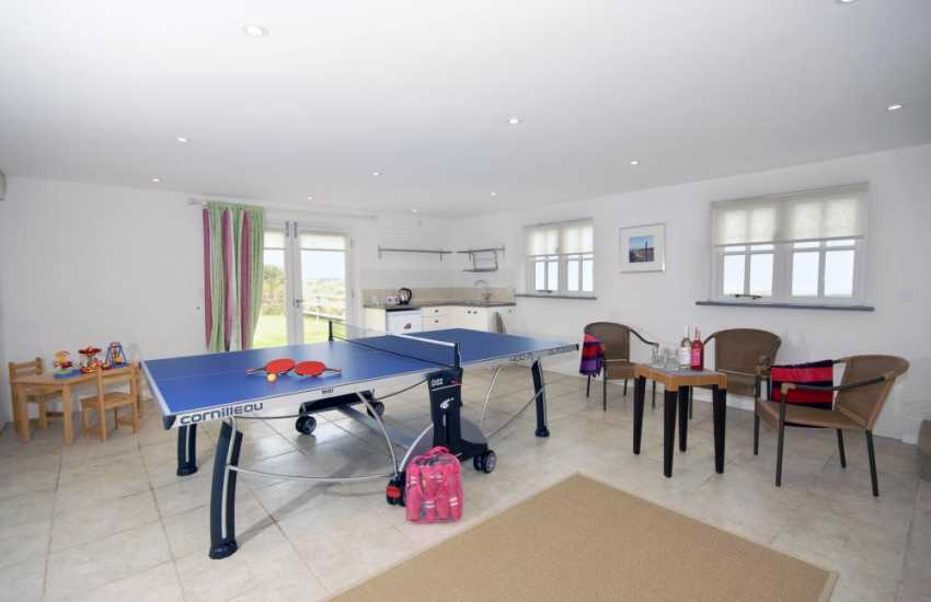 Large separate games room with full sized table tennis table