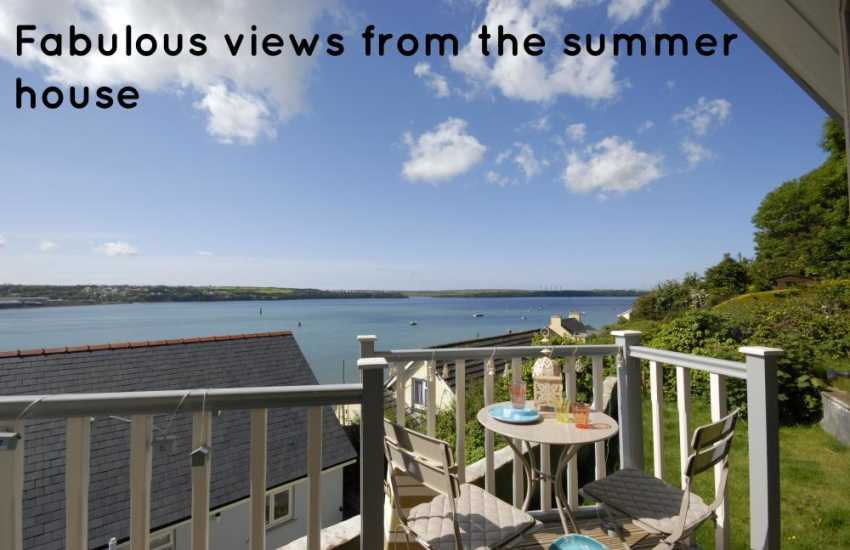 Enjoy panoramic views down river over the Haven Waterway from the 'cabin' at the top of the garden