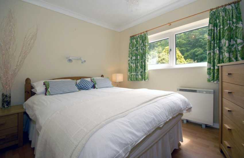 Solva holiday home - king size bedroom with garden views