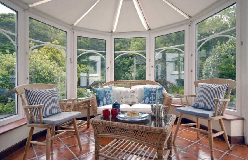 Sun room overlooking the garden at Solva holiday home
