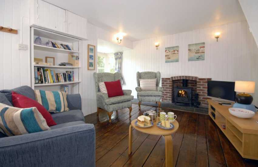 Solva, North Pembrokeshire holiday cottage - cosy living room with log burning stove