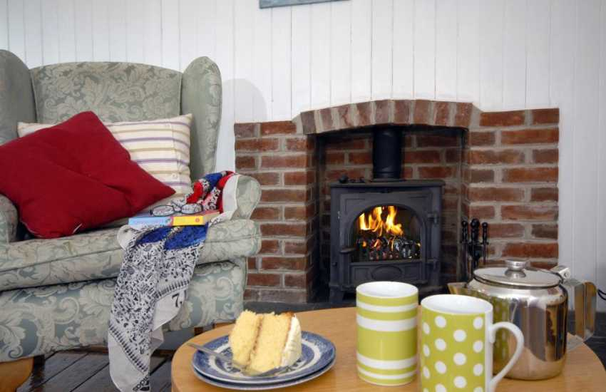 Chill out with tea and cake beside the fire at Upper Green Cottage