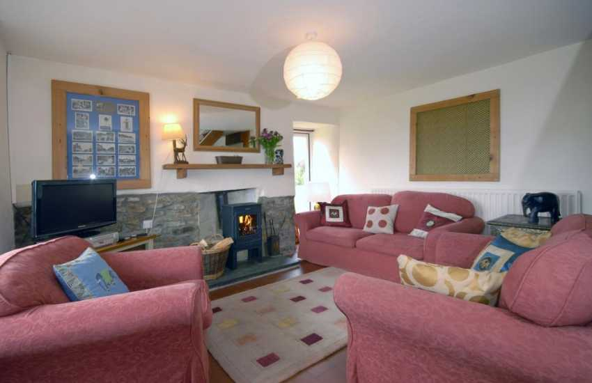 Pembrokeshire holiday cottage near the coast - cosy sitting room with wood burning stove
