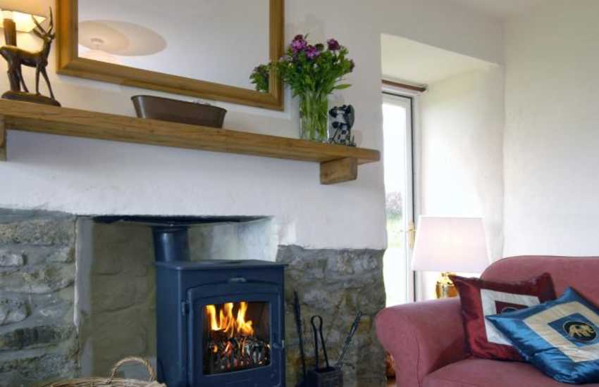 Cosy up by the wood burning stove in this remote coastal cottage