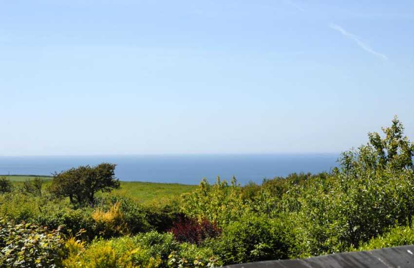 Views from the master bedroom over the surrounding countryside to the sea beyond