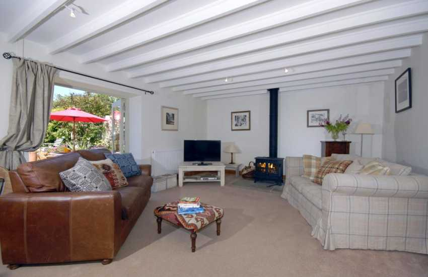 North Pembrokeshire coastal holiday cottage - sitting room with wood burning stove