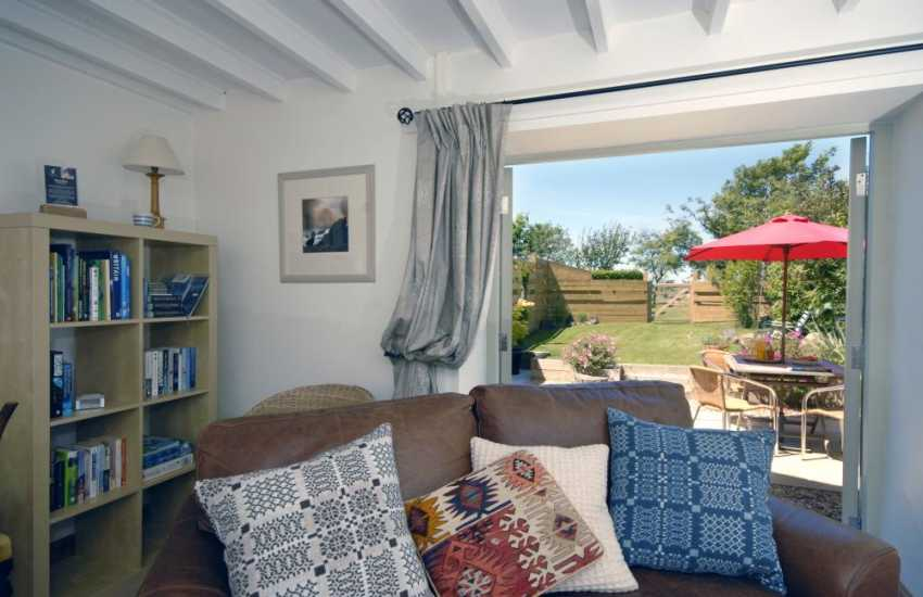 Pembrokeshire coastal holiday cottage sitting room with patio doors to the gardens