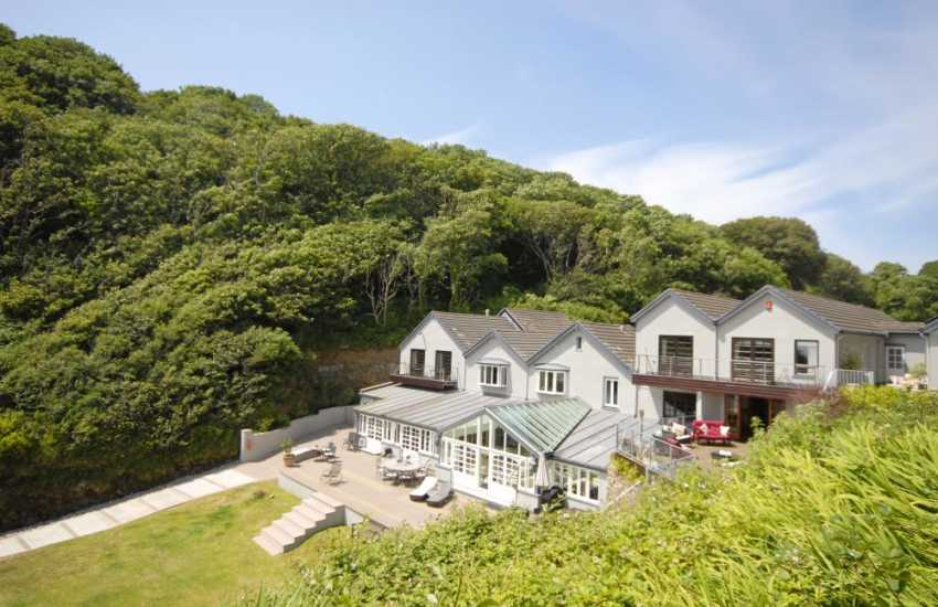 The Beach House overlooks the private sandy cove of Waterwynch Bay