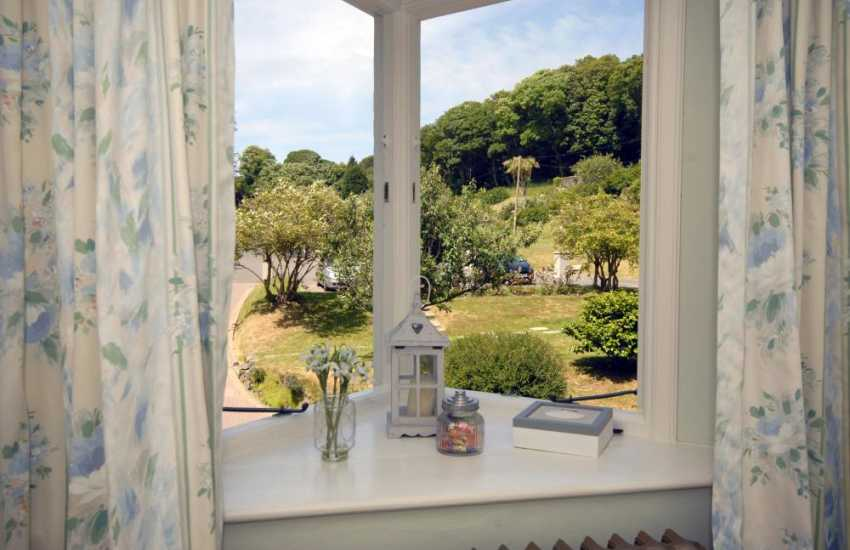 Wake up to lovely views over the gardens at The Beach House