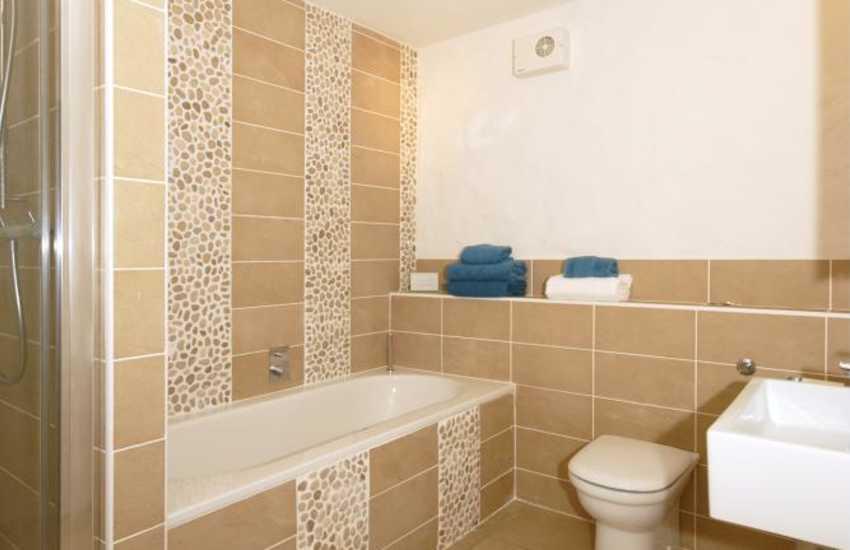 Lower ground floor bathroom with separate shower