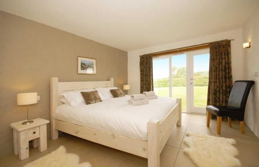 Upper ground floor bedroom - super king size bed and en-suite shower room