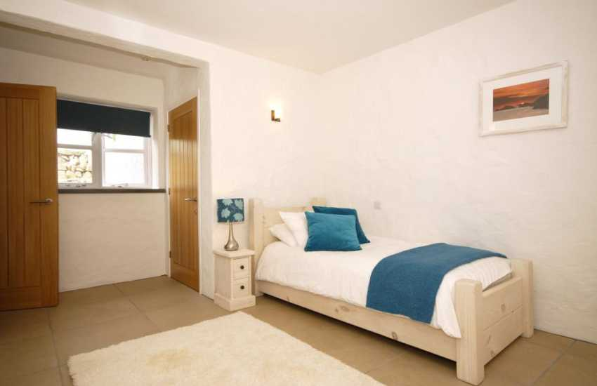 Large single bedroom on the lower ground floor
