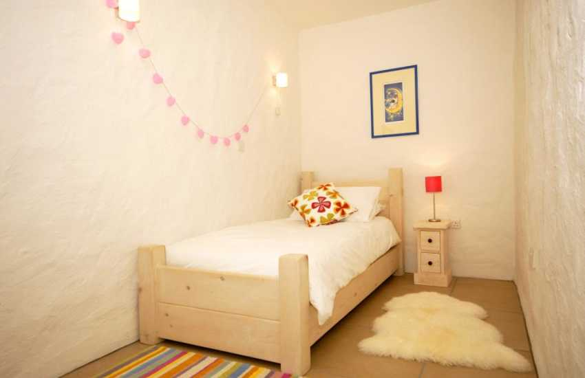 Single bedroom with small free-sat tv/dvd on the lower ground floor