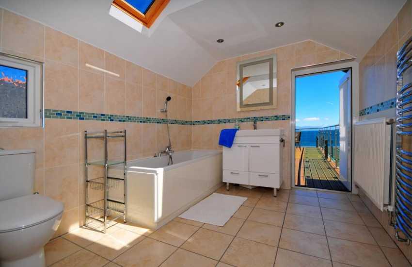 Bathroom door leading onto sun terrace in Criccieth