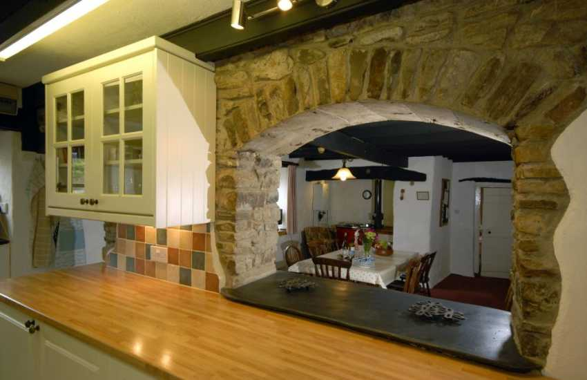 Peep through the stone arch 'serving hatch' in the kitchen