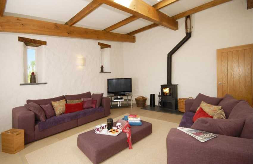 Lounge on entrance level with wood-burning stove and patio doors to the courtyard