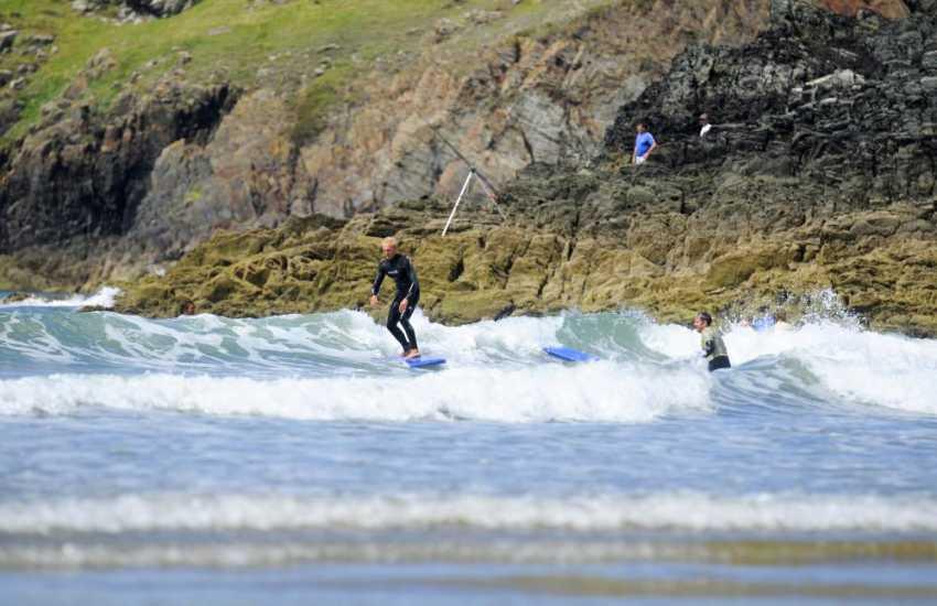 Whitesands Surf School hire wetsuits and surf boards down on the beach just a few yards from the car park