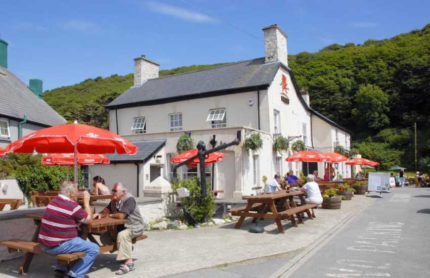 Eat at the Cambrian Restaurant, Number 35 or Harbour Inn which overlooks the river.