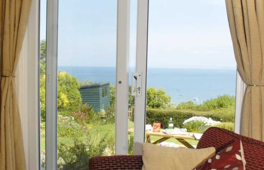 Views over the garden to the sea from the lounge