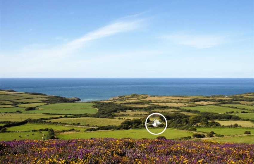 Stunning sea views over Strumble Head and 'Tai Bach' nestling in the hillside of Garn Fawr
