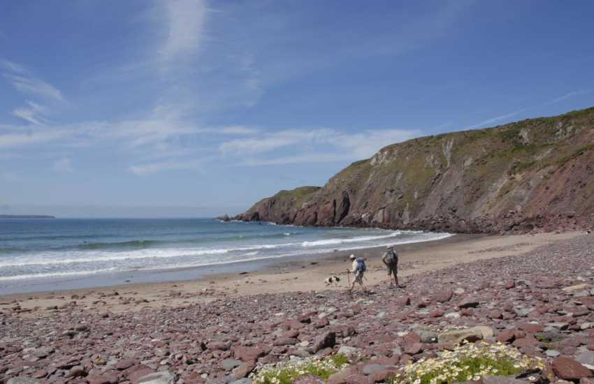 West Dale - a remote pebble sandy beach enclosed by towering cliffs accessible only by steep steps