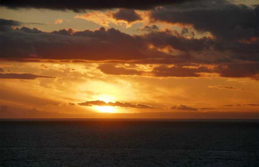 Watch amazing sunsets over the horizon