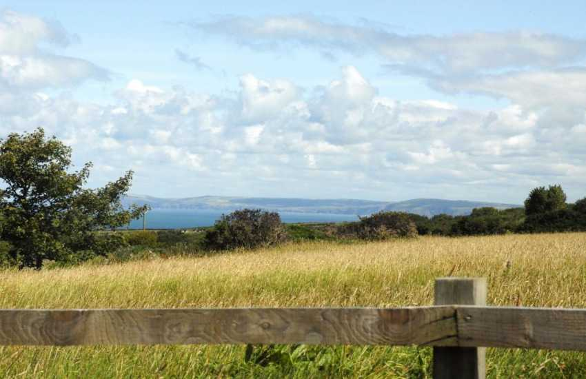 Sweeping views over The Strumble Head Peninsula and across the fields to Dinas Head and Newport beyond