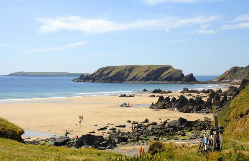 Marloes Sands (N.T), a huge sandy beach at low tide, perfect for rock pooling, fossil hunting and body boarding