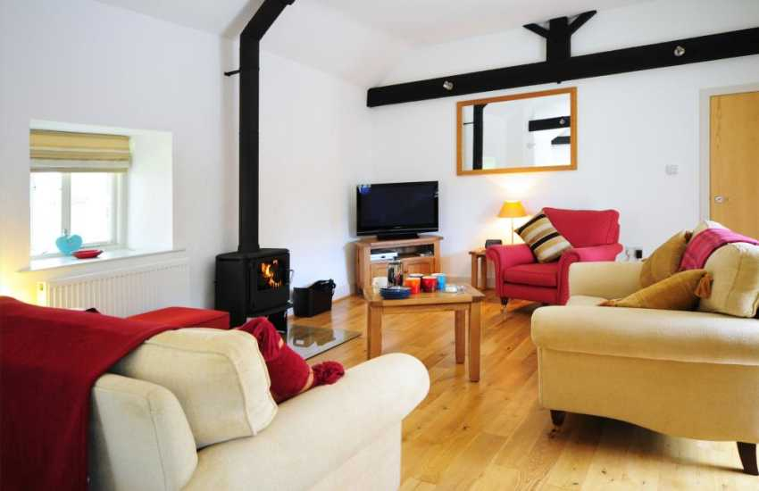 Spacious lounge with log burner in cottage near Newborough Warren