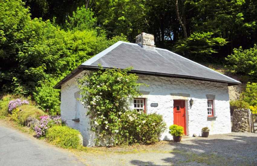 Pets welcome at woodland retreat holiday cottage on the banks of the River Gwaun
