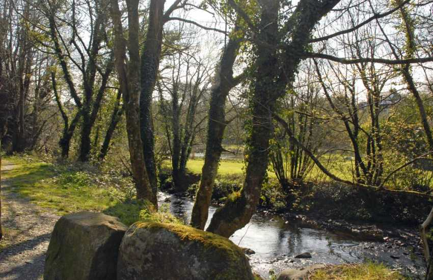 River Gwaun borders the unenclosed   gardens at Court Lodge - a wonderful place to relax and unwind down by the waters edge