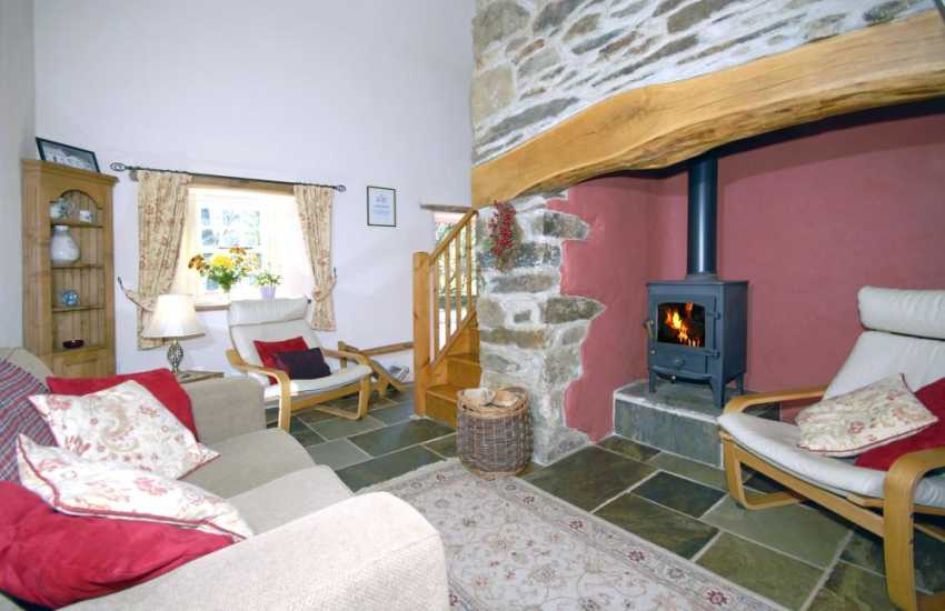 Pembrokeshire National Park holiday home - cosy lounge   with inglenook fire place and wood burning stove