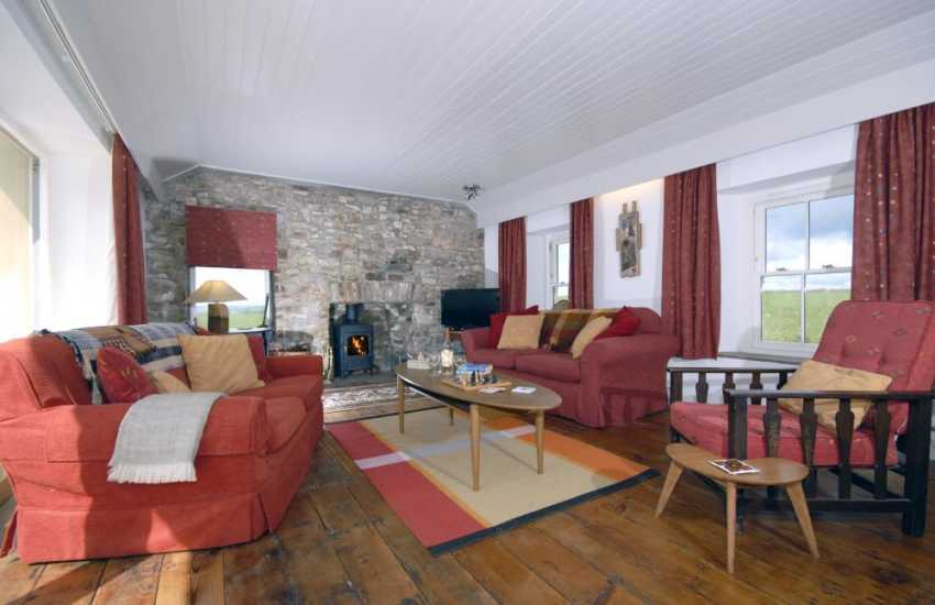 Cottage for holidays near Druidston Beach, Pembrokeshire - cosy lounge with sea views and wood-burning stove