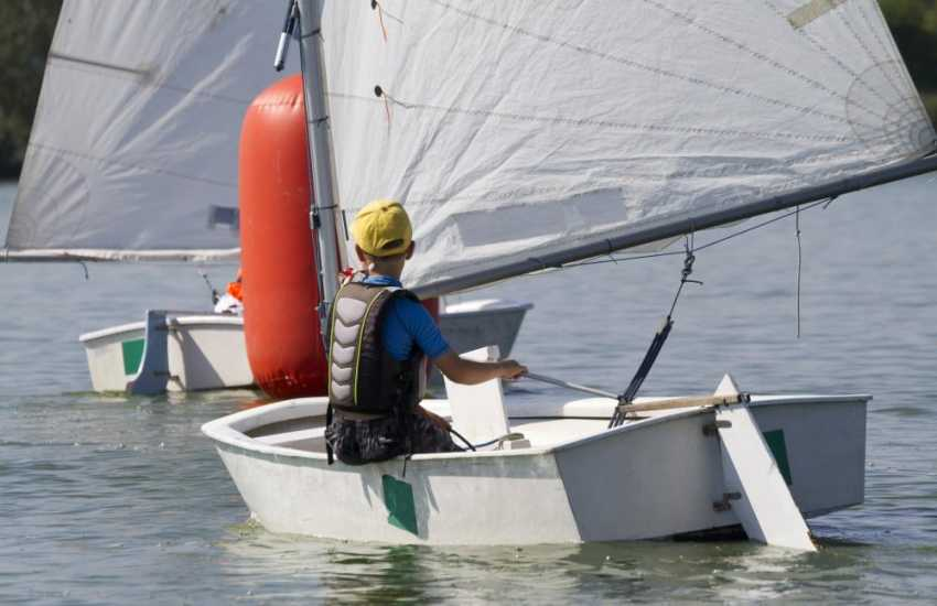 Visit Solva Sailboats for dinghy tuition, dinghy hire, powerboat courses or just enjoy sailing in St Brides Bay