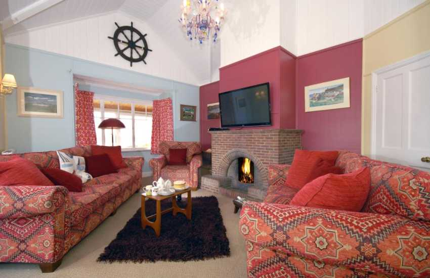 St Justinians classic colonial style bungalow - lounge with open fire