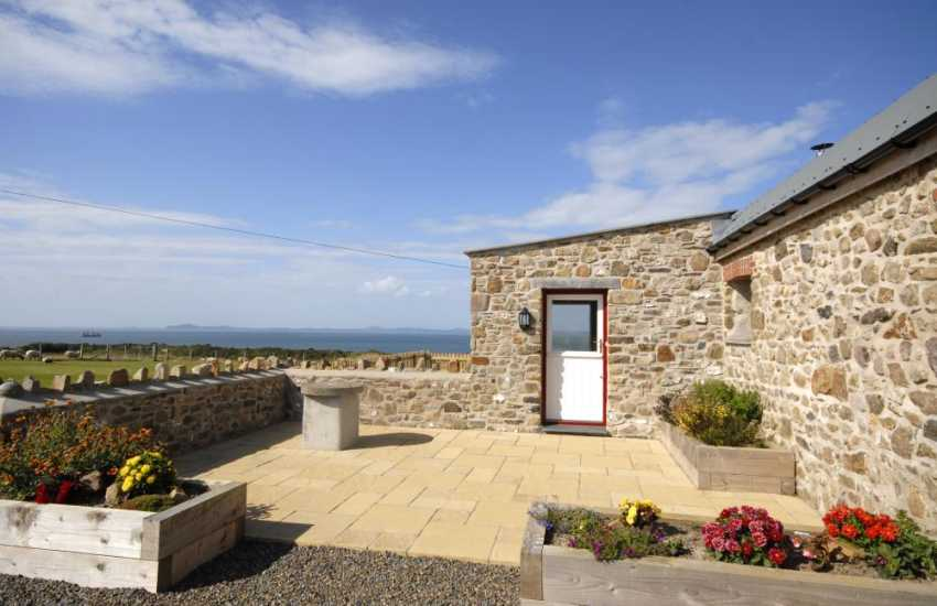 Martins Haven restored stables - patio with sea views
