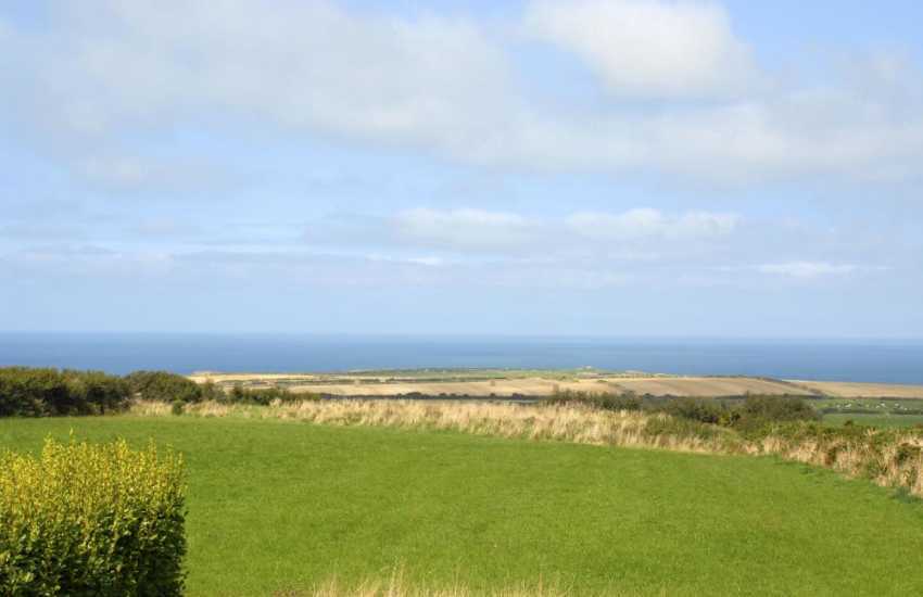 Enjoy fabulous panoramic views over the surrounding countryside to the coast beyond