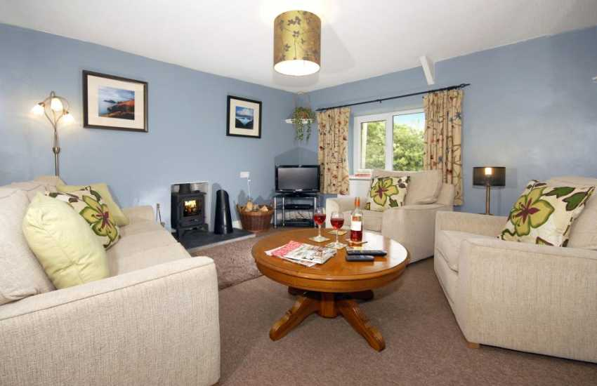 Pembrokeshire coastal cottage for holidays by the sea - comfy lounge with wood burning stove
