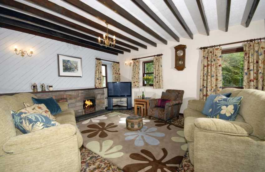 Pembrokeshire coastal cottage - comfy lounge with open fire