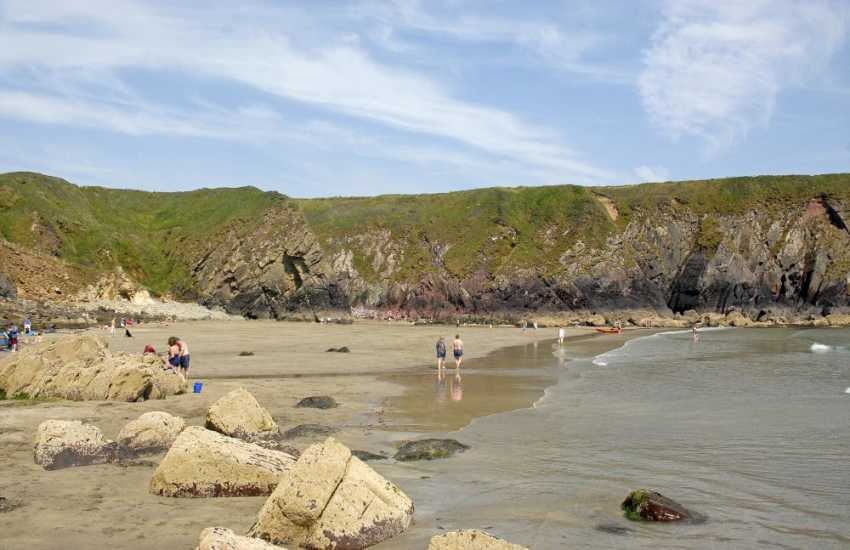 Caerfai Beach - a lovely south facing sandy beach sheltered by the surrounding cliffs