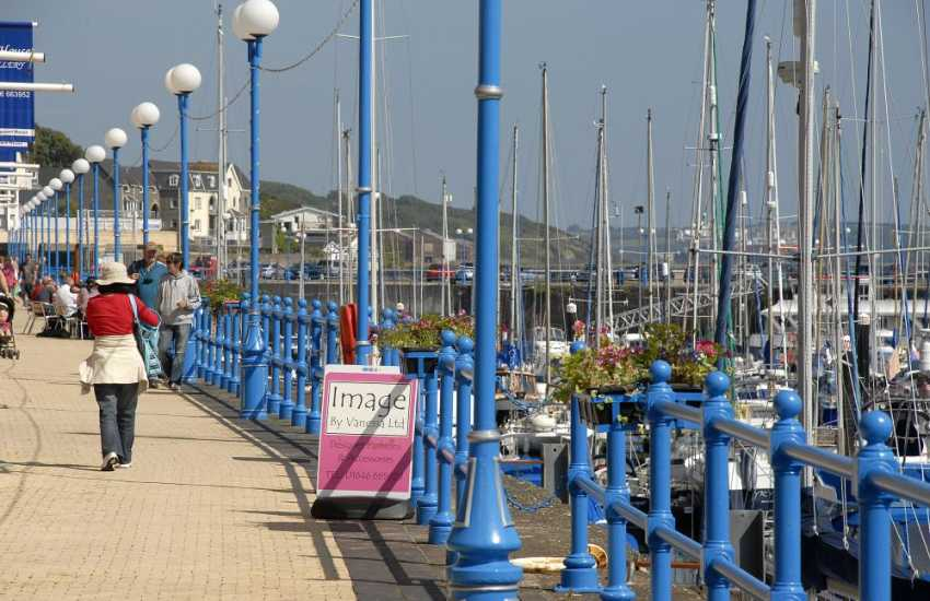 Enjoy alfresco dining or a leisurely stroll along side Milford Marina
