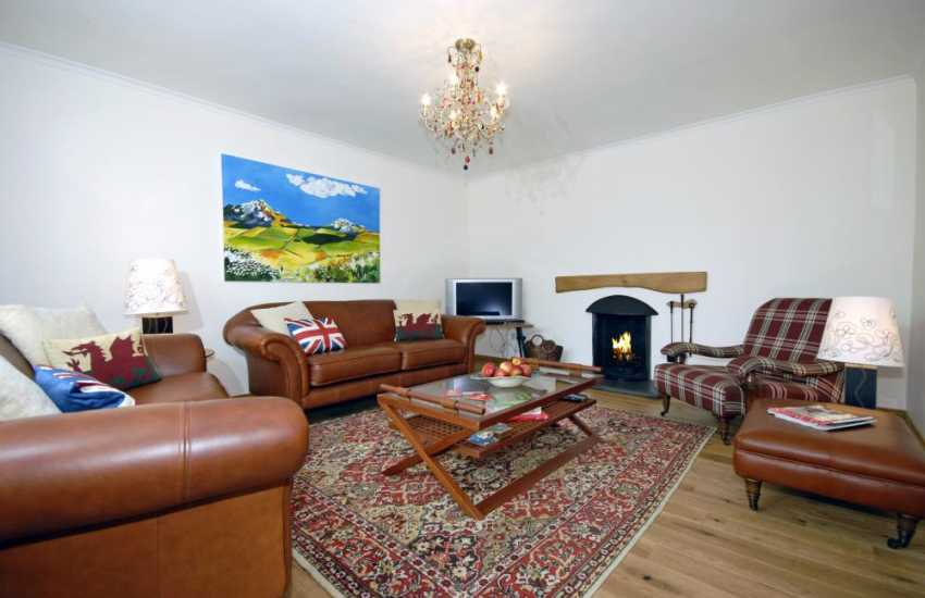 North Pembrokeshire coastal holiday cottage - sitting room with open fire