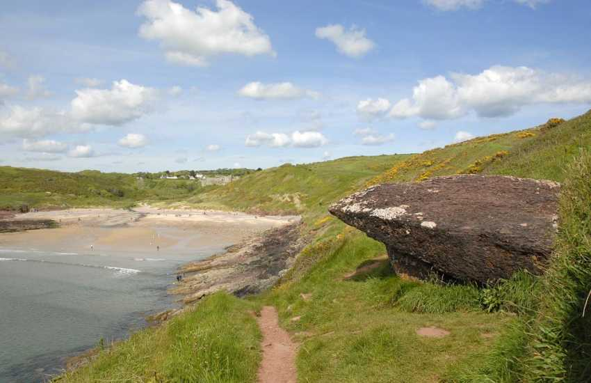 Manorbier - a favourite surfing beach and dog friendly throughout the year