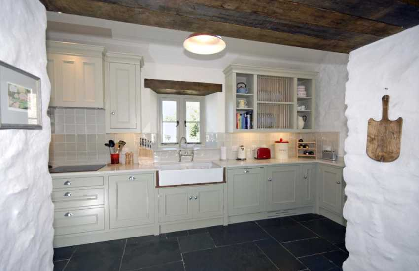 Self-catering family home in Solva - modern galley style kitchen