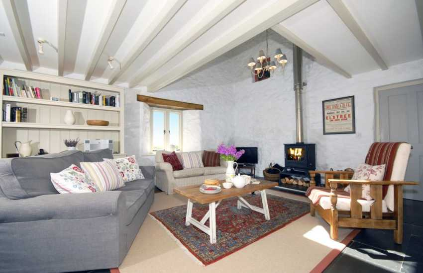 Luxurious holiday cottage in Solva - lounge area with wood burning stove