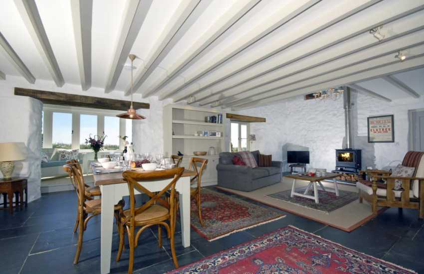 Solva holiday home - open plan living area and wood burning stove