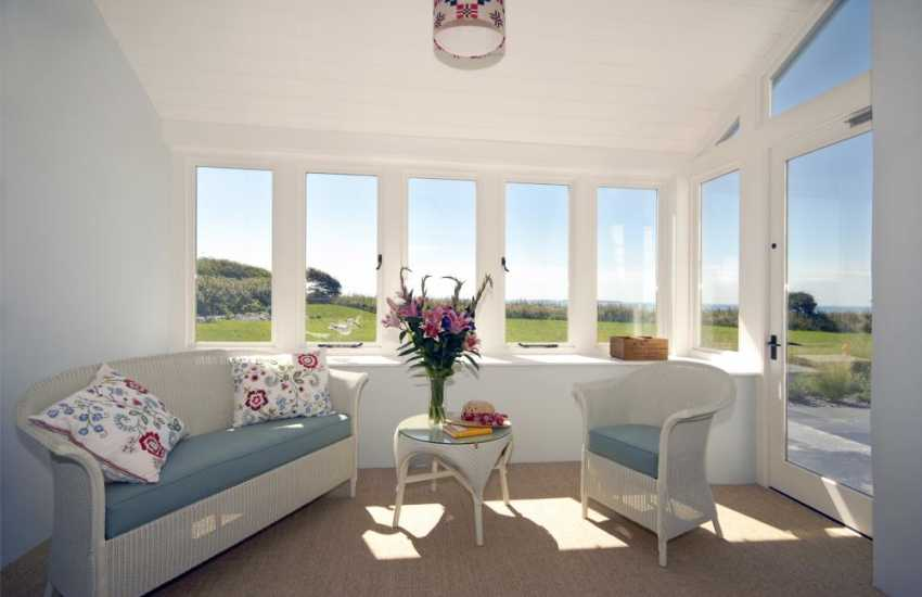 Solva holiday home with sunroom overlooking the gardens and coast