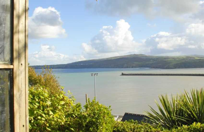 Pembrokeshire cottage with panoramic sea views from the secluded patio at the top of the gardens
